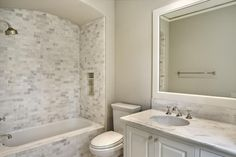 love the subway tile and vaulted ceiling