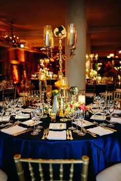 Vintage Gold and Navy Table Setting | Pen Carlson Photography https://www.theknot.com/marketplace/pen-carlson-photography-chicago-il-199765 | Architectural Artifacts https://www.theknot.com/marketplace/architectural-artifacts-chicago-il-344546