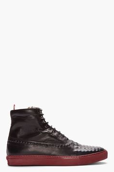 Alexander Mcqueen Black Hand_embossed Leather Sneakers -  Alexander Mcqueen Black Hand_embossed Leather Sneakers Alexander Mcqueen High_top buffed leather sneakers in black. Hand_embossed pattern throughout. Round toe. Tonal zip_up closure with three lace hooks. Exposed zip closure at interior face. Pull loop at heel collar. Fully lined in nude beige...