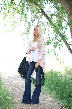 Love this! The flare/bell bottom jeans, the loose flowy tops (although I don't like how long the kimono falls in the back) and big fringe handbag