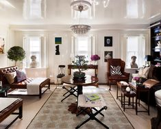 White lacquered ceiling & walls. Black, white & brown decor. Skull painting. Aman Carson, Kips Bay Decorator Show House.