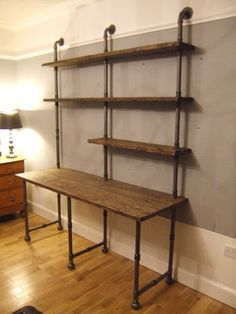 Vintage Industrial Styled Iron Gas Pipe & Reclaimed Timber Planks Desk & Shelving Unit Bespoke finishes, sizes and alternative arrangements of iron pipe frames and shelves can be made to suit the… Vintage Industrial Furniture, Industrial Interiors, Industrial House, Industrial Closet, Industrial Pipe Desk, Industrial Style Bedroom, Industrial Decorating, Industrial Shelving Kitchen, Industrial Boys Rooms