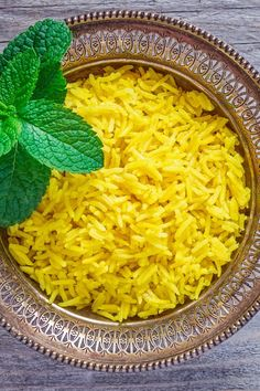 Turmeric Rice Recipe with coconut oil, onion, garlic, basmati rice, broth, and bay leaf #turmeric #rice #recipes #sidedish Turmeric Recipes, Lime Rice, Grocery Coupons, Rice Recipes, Macaroni And Cheese, Onion, Side Dishes, Garlic, Salt