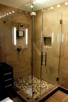 Big tiles on wall, small tiles on floor of shower
