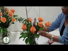 How to arrange a dozen roses in a vase.  (Except it's important to cut your stems under water.)