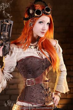 I needs this!  **From Lost Legends shop...Ornate Steampunk Corset of brown brocade with leatherette trim, laced in the back, front closure with hook rail and ornate brass buckles. The corset is decorated with high quality spiral and flat bars and reinforced at the waist.