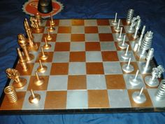 Chess made of engine parts. http://redd.it/p7sdn