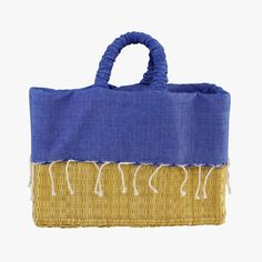 This denim blue lined basket tote from Scents and Feel is the perfect summer accessory. This chic tote features a small inside pocket.