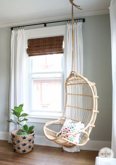 S&L chair w woven wood shades, white curtains, and fiddle leaf fig in a woven wood planter