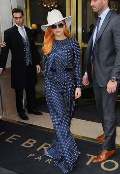 Paris Fashion Week wouldn't be complete with out Lady Gaga, the singer showed up sporting an outfit from Martin Grant's new collection.