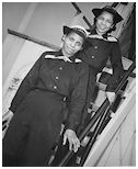 Two African-American Coast Guard SPARS at the U.S. Coast Guard Training Station, Manhattan Beach, Brooklyn, NY, during World War II. As hidden as women's history is from WWII, the contributions of black women during the war have almost been totally erased from history. http://Duster.me