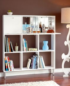 Redefine a bookshelf... Dreaming of a home bar but can't fit one into your tight space? See how they redefined a bookshelf to create a drinks cabinet.