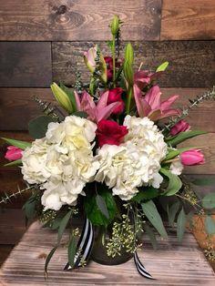 Look at this arrangement featuring hydrangeas, lilies, roses, & tulips! #hydrangeas, #lilies, #roses #tulips #eucalyptus