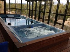 The rich wood tones and abundance of natural light on this 19' Dual-Temp Endless Pools® Swim Spa create an organic atmosphere for you to exercise or indulge.  For more ideas, visit http://www.endlesspools.com/tour-sunroom-pools.php.