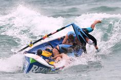 The Bungan surf life saving crew lose control of their boat during the Ocean Thunder Surf Boat Series at Dee Why Beach on February 2, 2013 in Sydney. (Cameron Spencer/Getty Images) #