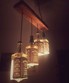 Wonderful Diy Bottle Lamp Design Ideas You Must Know - Lighted wine bottles are a creative way to light up a special occasion or give a unique gift to someone special. If you have a lot of empty bottles ar. Jack Daniels Lampe, Jack Daniels Bottle, Diy Bottle Lamp, Bottle Chandelier, Bottle Bottle, Luminaire Original, Diy Lampe, Lighted Wine Bottles, Liquor Bottle Lights