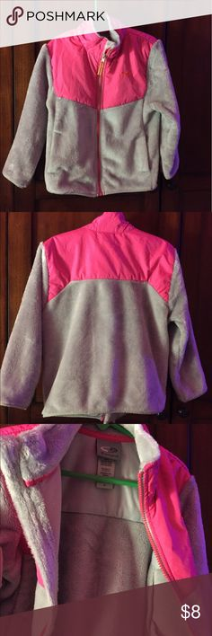 Girls soft fuzzy jacket Champion grey furry jackets with hot pink patches. Comes with zipper and patches. Very light weight.Perfect for fall weather and cool nights. Gentle use smoke free/pet free home. Champion Shirts & Tops Sweatshirts & Hoodies