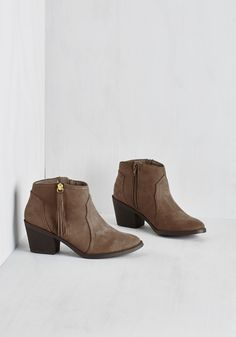 Lay of the Portland Bootie in Taupe. A walk through Washington Park never looked so good when youre sporting these burgundy booties! #tan #modcloth
