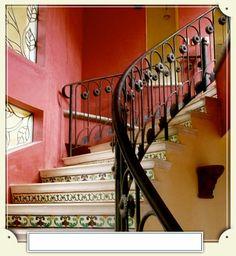 Luxury Villa Rental | Hacienda La Cresta, wroght iron railing, spiral staircase, Mexican tile on stair riser