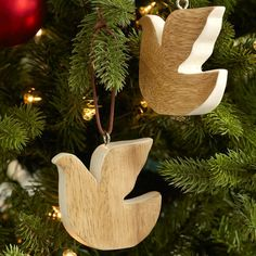 Made from acacia wood these hand crafted Christmas ornaments will add a natural appeal to your holiday decorations. Wooden Christmas ornaments