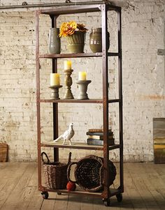 http://stores.ebay.com/sunandmoonhome  Beautiful, industrial, warm and functional. This Tall Wood and Iron Display with Five Shelves and Rolling Casters is a unique addition to your home. It features a strong iron frame and locking casters that allow you to wheel the shelving unit wherever you need it, then secure it in place for sturdy display and storage of your most precious things. Maximize storage with large spaces between shelves.