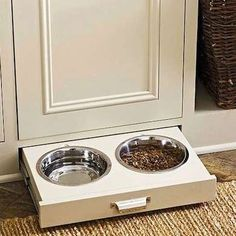 Pull Out Pet Bowls  This set of bowls slides out from a drawer under the cabinet, at the perfect height for a pet. Now, if you can just train Fido to close the drawer when he's finished.