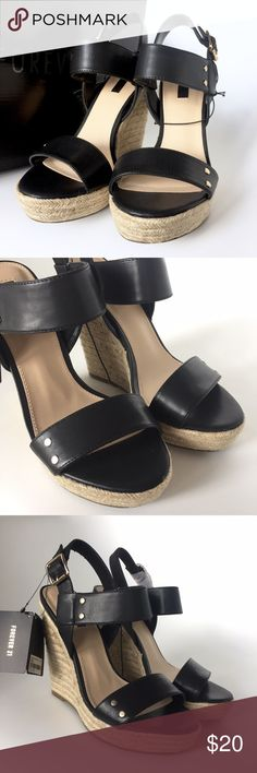 """NWT Forever 21 Espadrilles These gorgeous faux leather black espadrille wedges from Forever 21 feature gold tone accents and natural woven fiber on the heel. Cute buckle sling back detail. The wedge heel measure 5.25"""" (see last photo). Never been worn and includes box. No trades please  Forever 21 Shoes Wedges"""