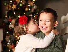 How to take pictures of your kids in front of a Christmas tree.