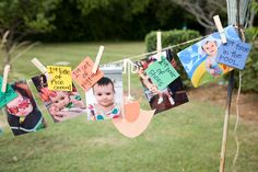 """Cute take on 1st birthday picture banner, could also hang all his """"first"""" onesies..."""
