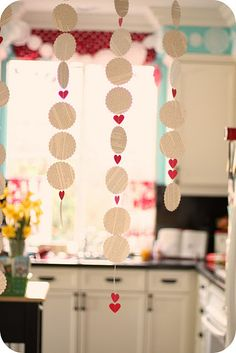 .valentines decorations - book pages small red hearts sewn together. paper craft could adjust for any occasion