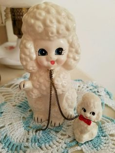 """Vintage poodle mama and puppy- Up for auction these two darling Poodle figurines, Mama and puppy . Wire has broke off on puppy and reattached around the neck. (missing second puppy). Measures approx large mom-4-3/4"""" puppy-1-3/4"""" Review all pictures before bidding. Please ask all questions before close of auction. Sorry no returns.   eBay!"""