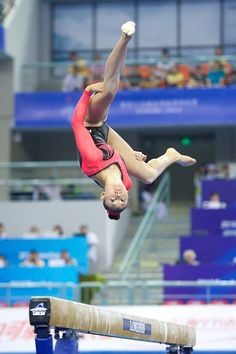 very odd picture of Kyla Ross but i love it anyway because it shows the height she gets above the beam.