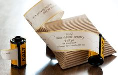 wedding invites in a FILM CANISTER!