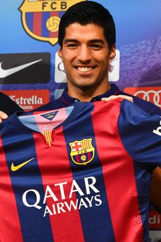 Luis Suarez of FC Barcelona poses for the media during a press conference as part of his presentation as new FC Barcelona player at Camp Nou on August 19, 2014 in Barcelona, Catalonia.