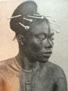 A woman with Scarification and painted facial patterns. The Congo. Image from Peoples of all Nations.