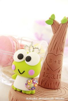 Keroppi Polymer Clay. I love the tree, inspires me to work on a tree piece with carvings in it.