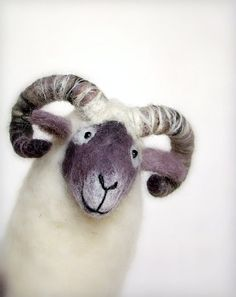 wonderful handmade felted puppets - love the faces on them. :)  by Two Sad Donkeys