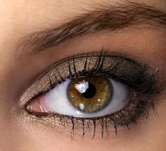 Eye Makeup For Brown Eyes | Brown eyes with metallic brown makeup.