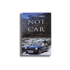 Not in That Car is the story of an Englishman who drove a thirty-two year old MG Midget car around the world, alone.