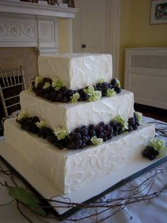 Buttercream Cupcakes Flowers Ribbon Square Wedding Cake Wedding Cakes Photos & Pictures - WeddingWire.com