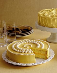 yellow frosted cake with white piped icing dots on plate
