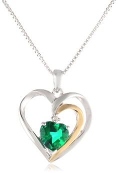 Two-tone sterling silver and 14k yellow gold create this elegant heart-shaped pendant. A colorful gemstone accent is presented in the center. The pendant is supported from an included 18-inch box chain.