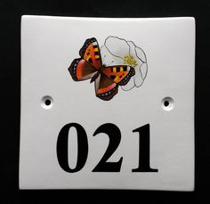 House Number Sign with Butterfly Hand painted ceramic house number signs with paintings of birds, flowers, trees, animals and more. See our many picture choices on our website www.handpaintedhousesigns.co.uk
