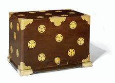 A Hasamibako [Travelling Chest]   Edo Period (19th century)   Decorated in gold hiramaki-e on a black ground with Tokugawa mon, elaborate engraved copper gilt fittings