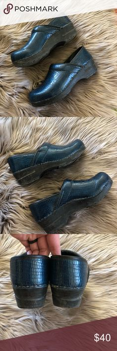 Danita Blue Snakeskin clogs size 38 Great pair of Sanita clogs size 38 in a cool navy blue snakeskin pattern. Good used condition with some light cleaning needed. I love these clogs and wish they were my size!   I accept all reasonable offers! Sanita Shoes Mules & Clogs