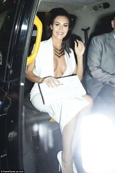 Making a statement: CBB star Chloe Goodman wowed in her plunging dress and white heels...