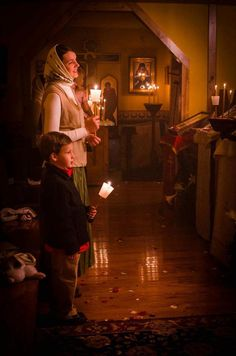 An Orthodox mother and her child are worshiping God together