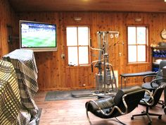 "Interior of a ""man cave"" on Orcas Island, WA: Weight room/media room. Constructed by Spane Buildings of Mount Vernon, WA."