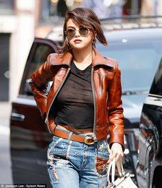 Flashin' star: Selena Gomez sported a sheer black top as she made her way home from the Coach New York Fashion Week presentation on Tuesday