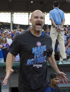 David Ross celebrates the Cubs' National League Central title Friday, Sept. 16, 2016, at Wrigley Field.